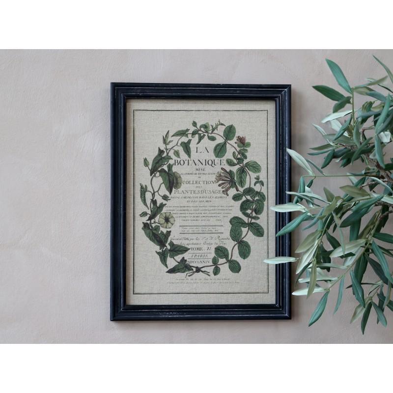 Billede med blomsterprint og sort ramme