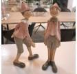 Pinocchio i lyserød sæt