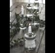 Glasstage med metallåg til bedelys